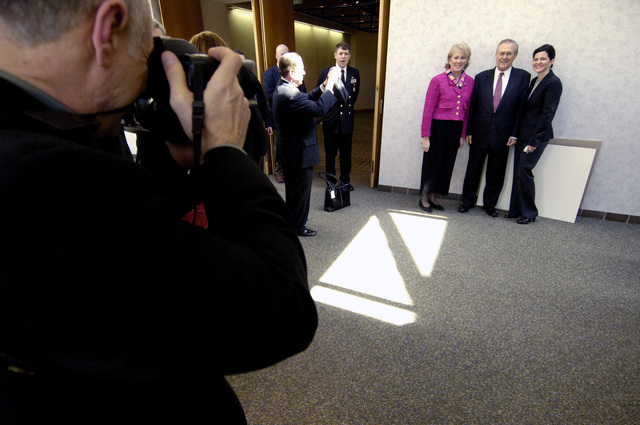 The Honorable Donald H. Rumsfeld, center, U.S. Secretary of Defense, poses for a photograph with patrons at the Harry S. Truman Presidential Library in Independence, Mo., on March 2, 2006. Sec. Rumsfeld was in Independence to pay tribute to the first U.S. president of the Cold War era and to consider what lessons might be drawn from that important period in our history. (DoD photo by PETTY Officer 1ST Class Chad J. McNeeley) (Released)