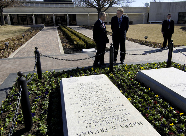 The Honorable Donald H. Rumsfeld, left, U.S. Secretary of Defense, is given a tour at the grave sites of the U.S. President Harry S. Truman and his wife, Mrs. Bess Truman, by museum director Mike Devine during his visit at the Harry S. Truman Presidential Library in Independence, Mo., on March 2, 2006. The purpose of his visit was to pay tribute to the first U.S. president of the Cold War era and to consider what lessons might be drawn from that important period in our history. (DoD photo by PETTY Officer 1ST Class Chad J. McNeeley) (Released)