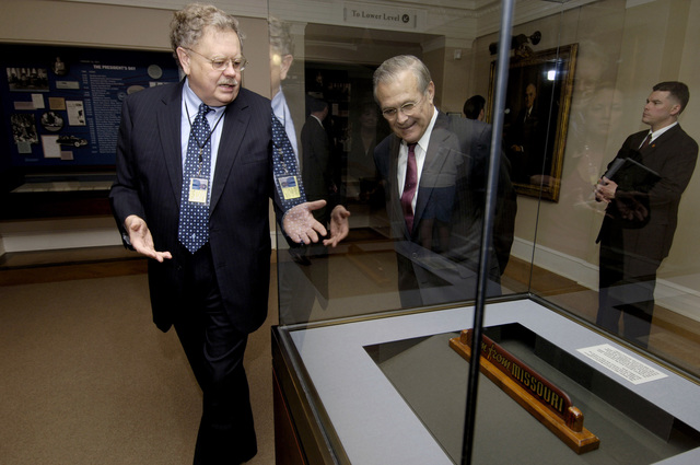 The Honorable Donald H. Rumsfeld, right, U.S. Secretary of Defense, is given a tour by museum director Mike Devine during his visit at the Harry S. Truman Presidential Library in Independence, Mo., on March 2, 2006. The purpose of his visit was to pay tribute to the first U.S. president of the Cold War era and to consider what lessons might be drawn from that important period in our history. (DoD photo by PETTY Officer 1ST Class Chad J. McNeeley) (Released)