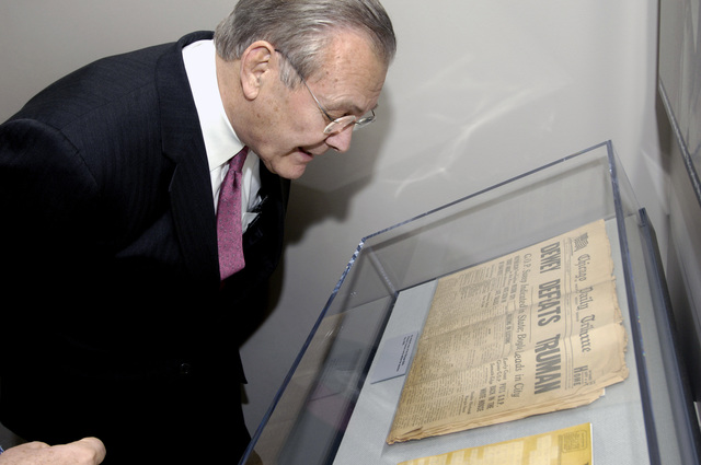 The Honorable Donald H. Rumsfeld, right, U.S. Secretary of Defense, views the newspaper that falsely declared U.S. President Harry S. Truman's defeat in the 1948 presidential election during his visit at the Harry S. Truman Presidential Library in Independence, Mo., on March 2, 2006. The purpose of his visit was to pay tribute to the first U.S. president of the Cold War era and to consider what lessons might be drawn from that important period in our history. (DoD photo by PETTY Officer 1ST Class Chad J. McNeeley) (Released)