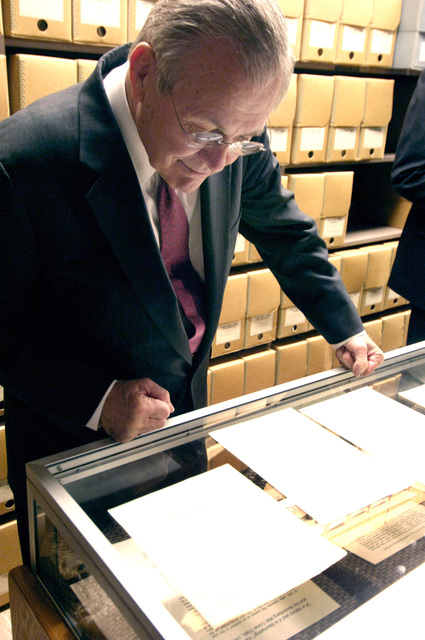 The Honorable Donald H. Rumsfeld, U.S. Secretary of Defense, views artifacts during his visit at the Harry S. Truman Presidential Library in Independence, Mo., on March 2, 2006. The purpose of his visit was to pay tribute to the first U.S. president of the Cold War era and to consider what lessons might be drawn from that important period in our history. (DoD photo by PETTY Officer 1ST Class Chad J. McNeeley) (Released)