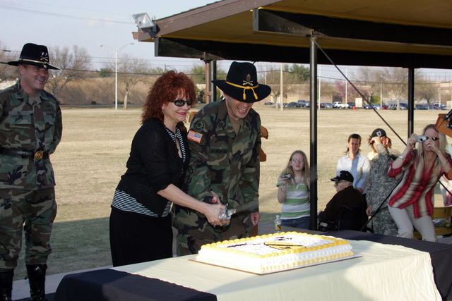 U.S. Army Command SGT. MAJ. Philip F. Johndrow, 1ST Cavalry Division, assumes responsibility as the First Team's top Non-Commissioned Officer (NCO).   During the ceremony, Command SGT. MAJ. Johndrow and his wife Vickie cut a cake on Guideon Field, at Fort Hood, Texas. (U.S. Army PHOTO by John Byerly, CIV) (Released)