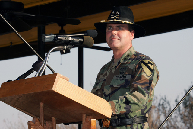 U.S. Army Command SGT. MAJ. Philip F. Johndrow, First Cavalry Division, Fort Hood, Texas, assumes responsibility as the First Team's top Non-Commissioned Officer (NCO).  During the ceremony, the First Cavalry Division Commander, MAJ. GEN. Joseph F. Fil, addresses the soldiers and guests in attendance. (U.S. Army PHOTO by John Byerly, CIV) (Released)
