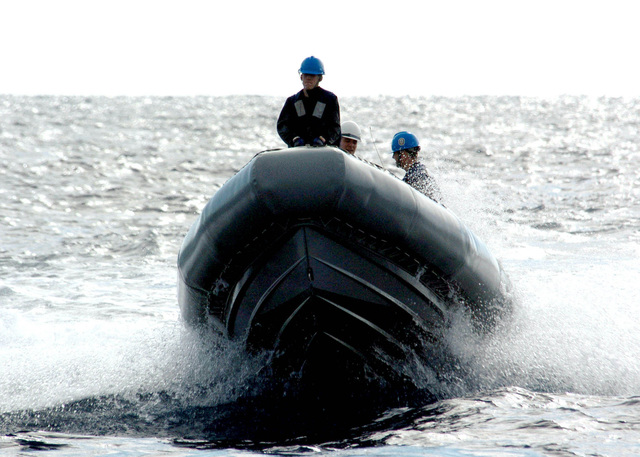 US Navy (USN) Sailors underway in the Atlantic Ocean on a Rigid-Hull Inflatable Boat (RHIB) being used to transport personnel from ship-to-ship during a Replenishment At Sea (RAS) exercise