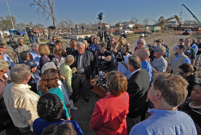 [Hurricane Katrina] New Orleans, LA, 3-3-06 -- House Minority Leader Nancy Pelosi, D-Calif, and House of Representatives Speaker Dennis Hastert R-Ill, speak to other lawmakers and the media at the site of 9th Ward Industrial Canal breach.  Speakers Hastert's delegation came to inspect the progress of recovery efforts in the Gulf Coast areas hit by Hurricanes Katrina and Rita.  Marvin Nauman/FEMA photo