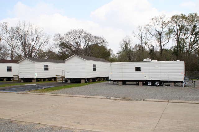 [Hurricane Katrina] Baton Rouge, LA, March 6, 2006 - Mobile homes and travel trailers are both supplied by FEMA as temporary housing options at FEMA/State developed group sites for homeowners or renters whose residences are unlivable as a result of the disaster.  Travel trailers are meant for shorter durations and are more maneuverable and easy to set up near the flood-victim's home.  Mobile homes are a bit larger and better suited for longer-term usage, but cannot be placed in the floodplain.  Robert Kaufmann/FEMA