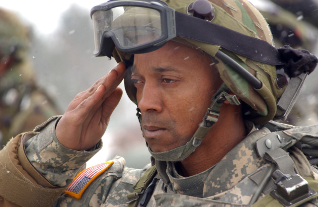 SGT. 1ST Class Duane Fauntleroy renders a salute while serving as honor guard for a notional funeral ceremony during Mission Rehearsal Exercise Noble Shephard at Hohenfels Training Area, Germany on March 6, 2006. SGT. 1ST Class Duane Fauntleroy is part of 1ST Battalion, 77th Regiment, 2nd Brigade Combat Team, 1ST Infantry Division. (U.S. Army PHOTO by SPC. Darian Anderson)
