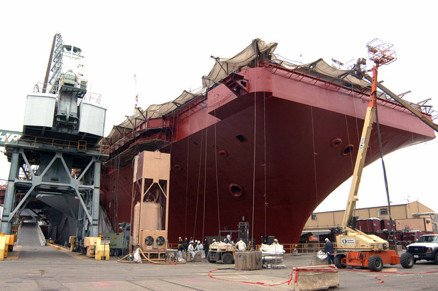 The US Navy (USN) Nimitz-class aircraft carrier USS CARL VINSON (CVN 70) sits in dry dock 11 at the Northrop Grumman Newport News shipyard painted red with primer for preservation. The VINSON is currently undergoing its scheduled refueling complex overhaul at Newport News, Virginia (VA)