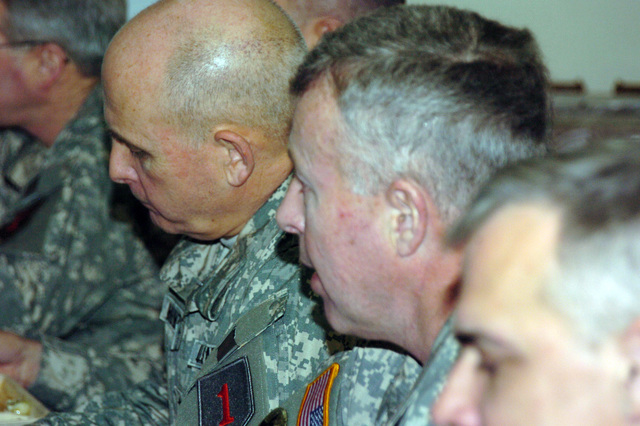 GEN. David D. McKiernan, USAREUR Commander, MAJ. GEN. Kenneth W. Hunzeker, 1ST Infantry Division Commander, and COL. J.B. Burton, Commander of 2nd Brigade Combat Team, 1ID, discuss 2BCT's future deployment in support of Operation Iraqi Freedom, 7 Mar. 2006, Hohenfels, Germany.  (U.S. Army photo by STAFF. SGT. Ricky Melton) (Released)