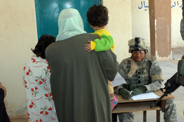 On March 8, 2006, U.S. Soldiers from Charlie, 2-22 Infantry on Military Police Liberty and Iraqi soldiers from 3rd Brigade, 6th Iraqi Army Division located on Forward Operating Base Constitution held a MEDCAP for the people of Al Jaddi Village. The purpose of the operation was to assist with humanity needs of local villagers and develop targetable intelligence. The MEDCAP was held at Al Jeel Al Arahi Primary School (Mix). U.S. Army SPC. Icess Evans maintained a count of how many people came through the MEDCAP.(U.S. Army photo by STAFF SGT. Kevin L. Moses Sr.) (Released)