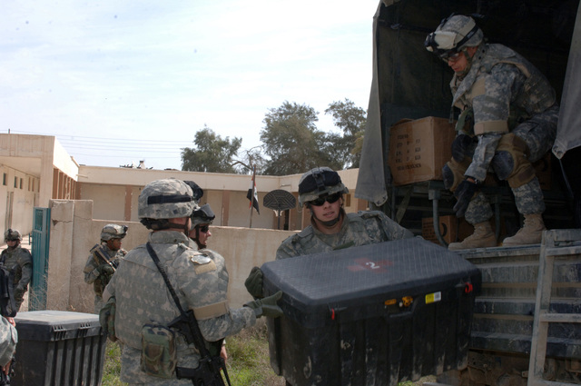 On March 8, 2006, U.S. Soldiers from Charlie, 2-22 Infantry on Military Police Liberty and Iraqi soldiers from 3rd Brigade, 6th Iraqi Army Division located on Forward Operating Base Constitution held a MEDCAP for the people in Al Jaddi Village. The purpose of the operation was to assist with humanity needs of local villagers and develop targetable intelligence. The MEDCAP was held at Al Jeel Al Arahi Primary School (Mix). Soldiers unloaded supplys from there truck.(U.S. Army photo by STAFF SGT. Kevin L. Moses Sr.) (Released)