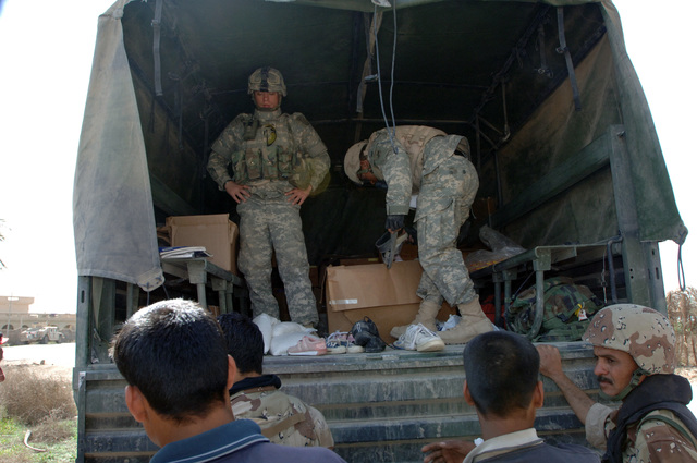 On March 8, 2006, U.S. Soldiers from Charlie, 2-22 Infantry on Military Police Liberty and Iraqi soldiers from 3rd Brigade, 6th Iraqi Army Division located on Forward Operating Base Constitution held a MEDCAP for the people of Al Jaddi Village. The purpose of the operation was to assist with humanity needs of local villagers and develop targetable intelligence. The MEDCAP was held at Al Jeel Al Arahi Primary School (Mix). Shoes, rice and candy were give from a truck at the last station.(U.S. Army photo by STAFF SGT. Kevin L. Moses Sr.) (Released)