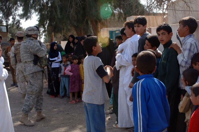 On March 8, 2006, U.S. Soldiers from Charlie, 2-22 Infantry on Military Police Liberty and Iraqi soldiers from 3rd Brigade, 6th Iraqi Army Division located on Forward Operating Base Constitution held a MEDCAP for the people of Al Jaddi Village. The purpose of the operation was to assist with humanity needs of local villagers and develop targetable intelligence. The MEDCAP was held at Al Jeel Al Arahi Primary School (Mix). The entrance to the school stayed full.(U.S. Army photo by STAFF SGT. Kevin L. Moses Sr.) (Released)