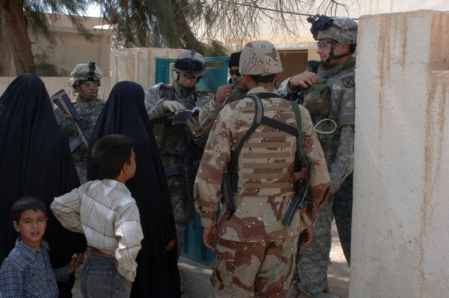 On March 8, 2006, U.S. Soldiers from Charlie, 2-22 Infantry on Military Police Liberty and Iraqi soldiers from 3rd Brigade, 6th Iraqi Army Division located on Forward Operating Base Constitution held a MEDCAP for the people of Al Jaddi Village. The purpose of the operation was to assist with humanity needs of local villagers and develop targetable intelligence. The MEDCAP was held at Al Jeel Al Arahi Primary School (Mix).(U.S. Army photo by STAFF SGT. Kevin L. Moses Sr.) (Released)