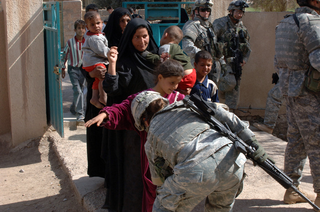 On March 8, 2006, U.S. Soldiers from Charlie, 2-22 Infantry on Military Police Liberty and Iraqi soldiers from 3rd Brigade, 6th Iraqi Army Division located on Forward Operating Base Constitution held a MEDCAP for the people of Al Jaddi Village. The purpose of the operation was to assist with humanity needs of local villagers and develop targetable intelligence. The MEDCAP was held at Al Jeel Al Arahi Primary School (Mix). PFC. Amber Running Wolf search women before they could enter.(U.S. Army photo by STAFF SGT. Kevin L. Moses Sr.) (Released)