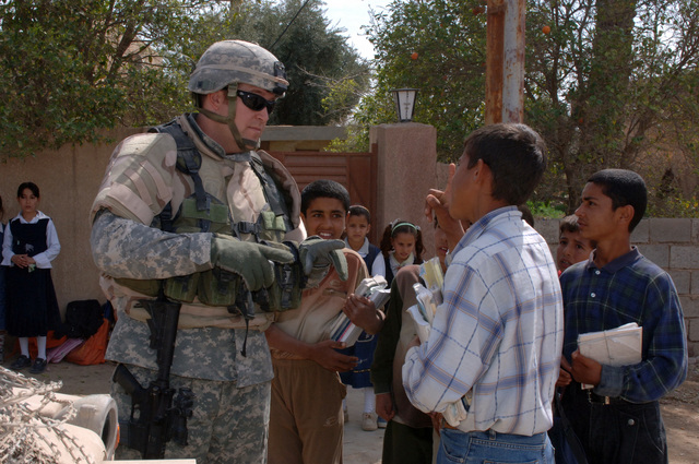 On March 8, 2006, U.S. Soldiers from Charlie, 2-22 Infantry on Military Police Liberty and Iraqi soldiers from 3rd Brigade, 6th Iraqi Army Division located on Forward Operating Base Constitution held a MEDCAP for the people in Al Jaddi Village. The purpose of the operation was to assist with humanity needs of local villagers and develop targetable intelligence. The MEDCAP was held at Al Jeel Al Arahi Primary School (Mix). U.S. Army SGT. Miller talked with children as they left school early.(U.S. Army photo by STAFF SGT. Kevin L. Moses Sr.) (Released)