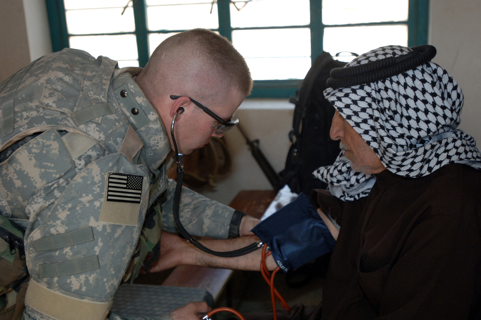 On March 8, 2006, U.S. Soldiers from Charlie, 2-22 Infantry on Military Police Liberty and Iraqi soldiers from 3rd Brigade, 6th Iraqi Army Division located on Forward Operating Base Constitution held a MEDCAP for the people of Al Jaddi Village. The purpose of the operation was to assist with humanity needs of local villagers and develop targetable intelligence. The MEDCAP was held at Al Jeel Al Arahi Primary School (Mix). A PA checks the blood pressure of a patient.(U.S. Army photo by STAFF SGT. Kevin L. Moses Sr.) (Released)