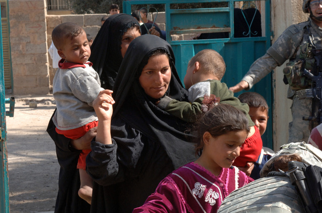 On March 8, 2006, U.S. Soldiers from Charlie, 2-22 Infantry on Military Police Liberty and Iraqi soldiers from 3rd Brigade, 6th Iraqi Army Division located on Forward Operating Base Constitution held a MEDCAP for the people of Al Jaddi Village. The purpose of the operation was to assist with humanity needs of local villagers and develop targetable intelligence. The MEDCAP was held at Al Jeel Al Arahi Primary School (Mix). Some women carried there children in.(U.S. Army photo by STAFF SGT. Kevin L. Moses Sr.) (Released)