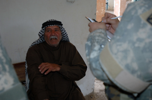 On March 8, 2006, U.S. Soldiers from Charlie, 2-22 Infantry on Military Police Liberty and Iraqi soldiers from 3rd Brigade, 6th Iraqi Army Division located on Forward Operating Base Constitution held a MEDCAP for the people of Al Jaddi Village. The purpose of the operation was to assist with humanity needs of local villagers and develop targetable intelligence. The MEDCAP was held at Al Jeel Al Arahi Primary School (Mix). A 70 year old local man coMilitary Policelains about back pains.(U.S. Army photo by STAFF SGT. Kevin L. Moses Sr.) (Released)
