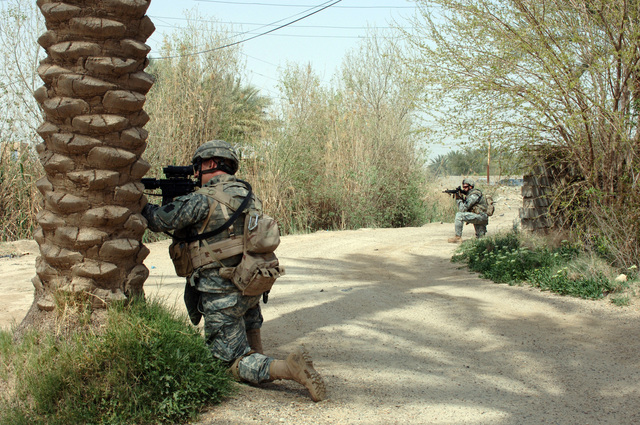 Members of B Company 1ST Battalion, 109th Infantry conduct a foot patrol through a local village outside of Forward Operating Base Blue Diamond near Ramadi, Iraq on March 13, 2006 as part of Operation Iraqi Freedom. (U.S. Army photo by SGT. 1ST Class David D. Isakson) (Released)