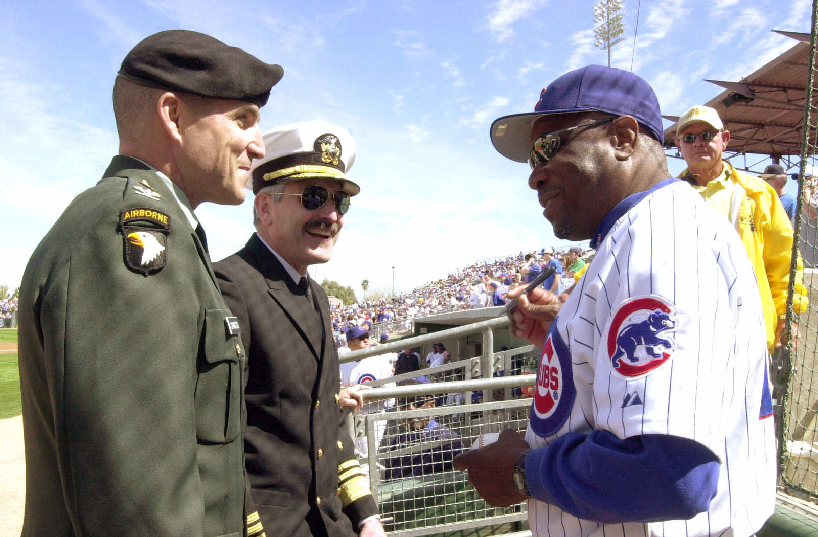 US Navy (USN) Vice Admiral (VADM) Evan M. Chanik, Director, Force Structure, Resources and Assessment and his aid, US Army (USA) Colonel (COL) Michael Linnington, get a baseball signed by Chicago Cubs Manager Dusty Baker, at a Phoenix, Arizona (AZ), training camp