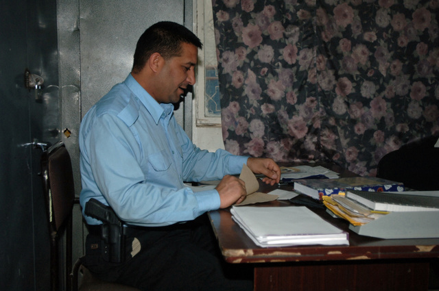 An Iraqi police officer does his daily paper work at the Kadhimya Police Station in Baghdad, Iraq, March 15, 2006.  (U.S. Army photo by STAFF SGT. Kevin L. Mosses Sr.) (Released)