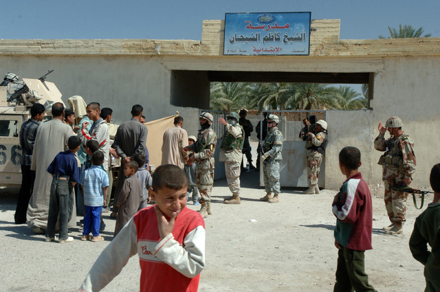 On March 17, 2006 soldiers from Bravo, 2-22 Infantry from Military Police Liberty and Iraqi soldiers from 3rd Brigade, 6th Iraqi Army Division located on Forward Operating Base Constitution held a MEDCAP for citizens of Bassam Village. The MEDCAP was held at Kardum Shihan School near Route Whalers. The purpose of the operation was to assist with humanitarian Iraqi Army needs and develop targetable intelligence. A group of people wait to enter the MEDCAP for treatment.(U.S. Army photo by STAFF SGT. Kevin L. Moses Sr.) (Released)