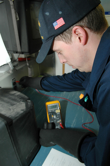 Onboard the US Navy (USN) Nimitz Class, Aircraft Carrier USS JOHN C. STENNIS (CVN 74), Interior Communications Electrician Fireman (ICFN) Ryan Turner, performs an electrical safety check on a 110-volt outlet. The STENNIS is currently underway in the Pacific Ocean conducting carrier qualifications