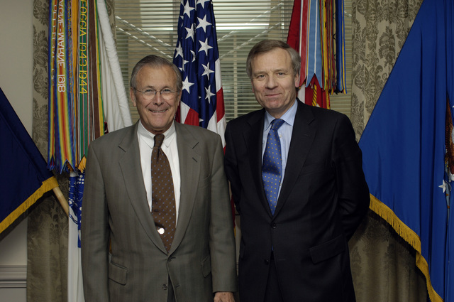 The Honorable Donald H. Rumsfeld (left), U.S. Secretary of Defense, poses for a picture with Jaap de Hoop, North Atlantic Treaty Organization (NATO) Secretary General, at the Pentagon, Washington, D.C., March 20, 2006.  (DoD photo by PETTY Officer 1ST Class Chad J. McNeely) (Released)