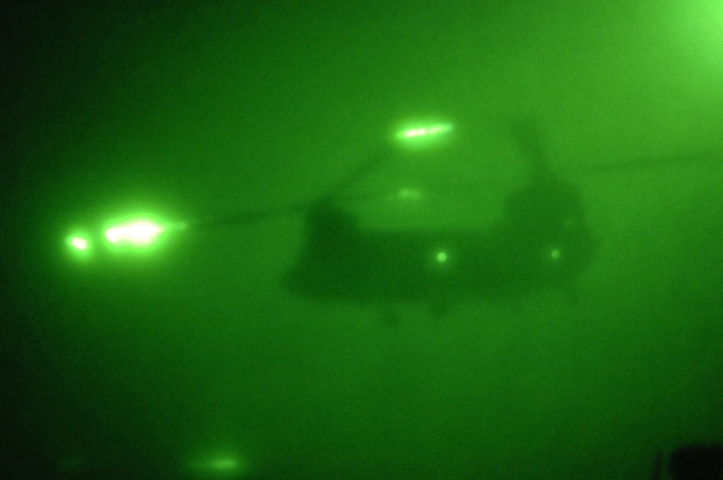 A U.S. Army CH-47 Chinook helicopter begins its ascent after inserting U.S. Army Soldiers from Charlie Company, 1ST Battalion, 187th Infantry Regiment, 101st Airborne Division during an air assault mission to root out insurgents at a possible training camp near Balad, Iraq, March 21, 2006.  (U.S. Army photo by SPC. Charles W. Gill) (Released)
