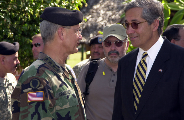 U.S. Army GEN. Bantz J. Craddock, Commander U.S. Southern Command and the U.S. Ambassador in the Dominican Republic Hon Hans H. Hertell, have a conversation prior to the New horizons 2006 opening ceremony in Barahona, Dominican Republic on March 21, 2006. New Horizons 06 is a humanitarian assistance project held in Barahona, Dominican Republic that will benefit the rural towns and populace with the construction of 4 clinics and basic medical care. NH06 is sponsored by U.S. Southern Command and executed by U.S. Army South alongside the Government of the Dominican Republic. (U.S. Army photo by Miguel A. Negron) (Released)