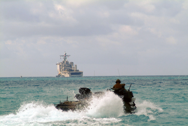 A US Marine Corps (USMC) Amphibious Assault Vehicles (AAV7A1) from the 31st Marine Expeditionary Unit (MEU), maneuvers through the water in the Sea of Japan as it approaches the well deck of the US Navy (USN) Dock Landing Ship USS HARPER'S FERRY (LSD 49). Elements of the USMC 31st MEU are being loaded at White Beach, Okinawa, Japan, as part of the Spring Patrol for the Amphibious Ready Group (ARG)