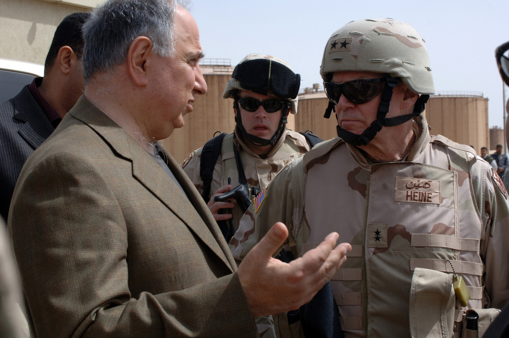 Deputy Prime Minister of Oil Chalibi speaks to MAJ. GEN. Robert Heine, Director, Iraqi Reconstruction Management Office while visiting the Bayji, Iraq oil refinery on March 22, 2006.  Chalibi and Coalition dignitaries visit was to conduct an assesment of the refinery and see what steps should be taken to more efficiently distribute gas products throughout the country.     (U.S. Army photo by SPC. Charles W. Gill) (Released)