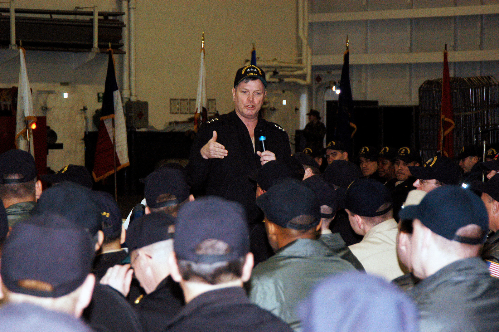 """At the Norfolk Naval Base (NB), Virginia (VA), US Navy (USN) Vice Admiral (VADM) Walter Massenburg addresses Sailors in the hangar bay aboard the USN Nimitz Class Aircraft Carrier USS GEORGE WASHINGTON (CVN 73), during the first ever """"Boots on the Deck"""" visit to an aircraft carrier"""
