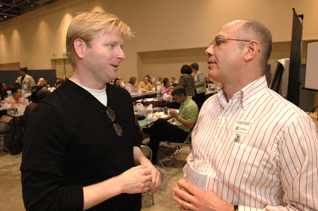 [Hurricane Katrina] Biloxi, Miss., March 23, 2006 -- FEMA Volunteer Agency Liaison (VAL) Lead David Turner (left) speaks with Warren Harrity, Executive Director of United Methodist Committee on Relief (UMCOR) and Katrina Aid Today at the FEMA Joint Field Office (JFO).  Case managers from Katrina Aid Today are undergoing training at the JFO.  Mark Wolfe/FEMA