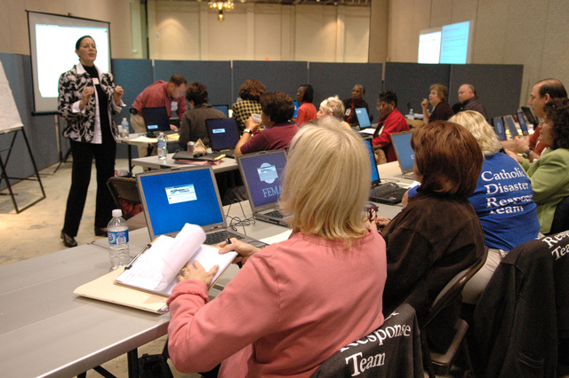 [Hurricane Katrina] Biloxi, Miss., March 23, 2006 -- United Methodist Committee on Relief (UMCOR) representative Catherine Earl teaches computer skills to case managers from Katrina Aid Today including those from the Catholic Disaster Response Team.  The case managers from are undergoing training at the FEMA Joint Field Office (JFO).  Mark Wolfe/FEMA