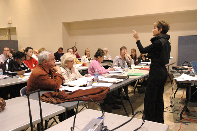 [Hurricane Katrina] Biloxi, Miss., March 23, 2006 -- United Methodist Committee on Relief (UMCOR) representative Christy Smith (right) speaks to Katrina Aid Today case managers.  The case managers are undergoing training at the FEMA Joint Field Office (JFO).  Mark Wolfe/FEMA