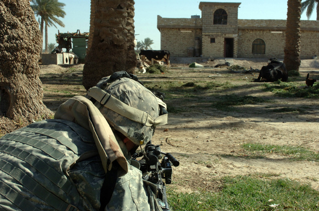On March 23, 2006 soldiers from 10th Mountain, 2nd Battalion, 22nd Infantry conducted cordon and search operations in Banizaid, Ramadi. Soldiers Air Assaulted in during the early morning hours to search the area for suspected terrorist and insurgent. PFC. David Bakies from C Co 2-22 Infantry provides outter security to fellow soldiers while a home was being searched.(U.S. Army photo by STAFF SGT. Kevin L. Moses Sr.) (Released)