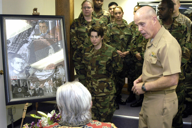 The Commanding Officer (CO) of US Navy (USN) Survival, Evasion, Resistance and Escape (SERE) School, Captain (CAPT) Jim J. Gillcrist, presents a photo collage to Sybil Stockdale in honor of her late husband, Vice Admiral (VADM) James B. Stockdale, at Naval Base (NB) Coronado, California (CA)