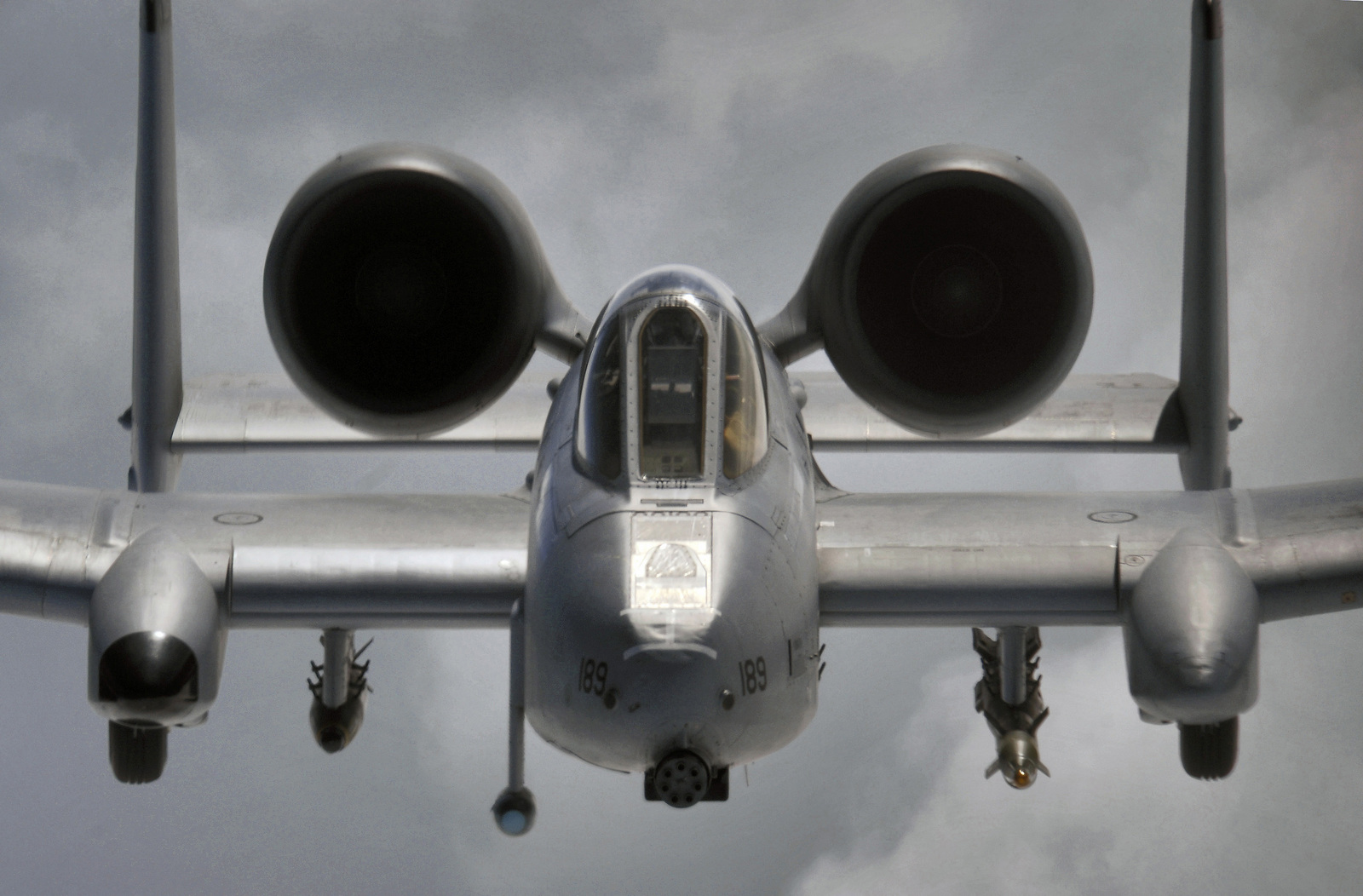 Head on aerial of a US Air Force (USAF) OA/A-10 Thunderbolt II observation/attack aircraft, piloted by USAF Captain (CPT) Andrew Quinn, 355th Expeditionary Fighter Squadron (EFS), Bagram Air Base (AB), Afghanistan (AFG), over Afghanistan