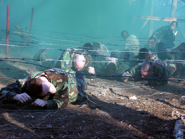 US Air Force (USAF) and US Navy (USN) Students participating in the USAF Phoenix Raven Class 06-D at Fort Dix, New Jersey (NJ), pull simulated patients through an obstacle course during combat first aid training. Under the direction of the Air Mobility Warfare Center's 421st Combat Training Squadron (CTRS), USAF Security Police and USN Masters at Arms personnel, receive training in everything from combat first aid and tactical self-defense to aircraft security