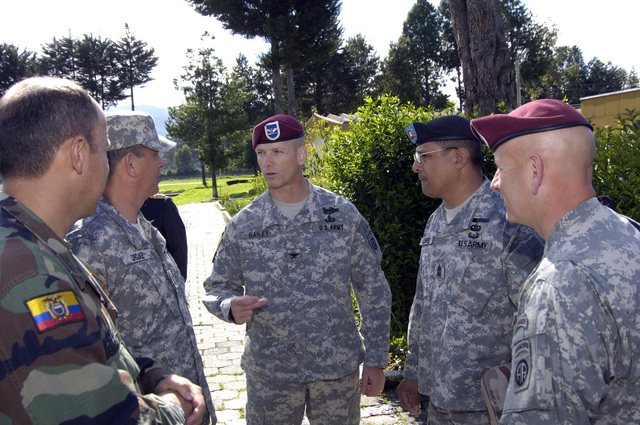 "U.S. Army COL. Jeffrey Bailey, Commander, 2nd Brigade Combat Team, 82nd Airborne Division, Ft. Bragg, N.C., center, talks with Ecuador LT. COL. Gustavo Villacis, Director of the""Escuela de Infanteria""(Infantry School) (far left) during a visit to the Ecuadorian Sergeants Major Academy in Quito, Ecuador on March 27, 2006. Accompanying COL. Bailey from left are SGT. MAJ. Efran Ordaz, U.S. Army Sergeants Major Academy; SGT. MAJ. Jose Lopez, U.S. Army South Operations Sergeant Major; and Command SGT. MAJ. Donald Nauck, 2nd BCT Command Sergeant Major. (U.S. Army photo by Kaye RIchey) (Released)"