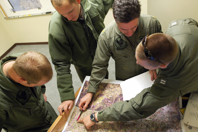 US Navy (USN) Lieutenant (LT) Greg C. Knutson (right), a Pilot assigned to Helicopter Anti-Submarine Squadron 2 (HS-2), briefs fellow pilots and air crew members while deployed at Osan Air Base (AB), Korea, during preparations for an evening Combat Search and Rescue (SAR) mission during Operation FOAL EAGLE