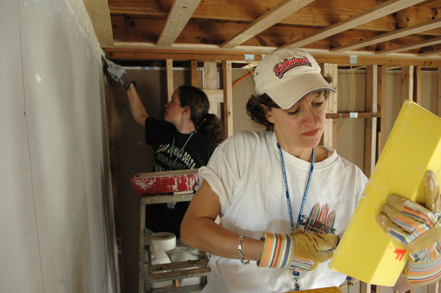 [Hurricane Katrina] D'Iberville, Miss., March 29, 2006 -- Presbyterian Disaster Assistance volunteers Julie Miller (foreground) and Sarah Nepple work on the sheetrock walls of the Dawson house in D'Iberville.  The Ms. Miller and Ms. Nepple have traveled from Missouri to help with the Hurricane Katrina rebuilding efforts.  Mark Wolfe/FEMA