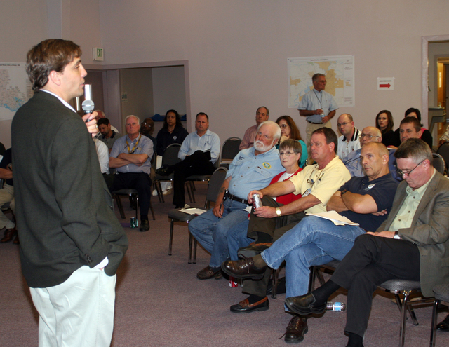 [Hurricane Rita] Lake Charles, LA, March 31, 2006 - Louisiana Recovery Authority's Andy Kopplin provides information on recovery activities at the Intergovernmental Affairs Information Day in Lake Charles.  This is one of many scheduled events to give opportunity to gather information on recovery efforts and to voice concerns as Louisiana moves forward.  Robert Kaufmann/FEMA