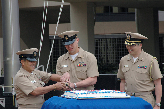 US Navy (USN) Sailors stationed at Navy Base San Diego, California (CA), participate in a Cake Cutting Ceremony honoring the 113th birthday of the Enlisted CHIEF PETTY Officer (CPO) rank. Pictured left-to-right: MASTER CHIEF Culinary SPECIALIST (MCCS) Aresnio Villanueva; CHIEF Fire Control Technician (FTC) Anthony Hampton; and Captain (CAPT) David Tam, Deputy Commander, Naval Medical Center, San Diego, CA. The rank of CHIEF PETTY Officer was officially recognized April 1, 1893