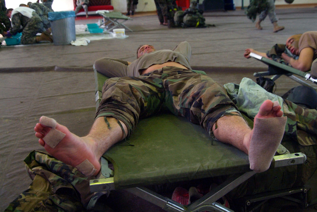 CAPT. Felix relaxes in the gym at Armstrong Kaserne after completing 9 tasks and walking over 30 miles in the past 33 hours. He is from the 1ST Armored Division, 1ST U.S. Cavalry Regiment and is participating in a Spur Ride held April 3 and 4, 2006 in Buedingen Germany. (U.S. Army photo by Martin Greeson) (Released)