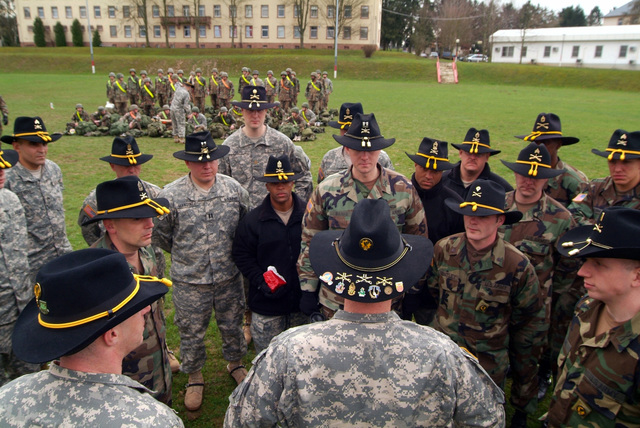 LT. COL. Peeler, Squadron Commander, addresses the Leadership as Command SGT. MAJ. Davenport addresses the Spur Candidates on the parade field in Buedingen, Germany. They are from 1ST Armored Division, 1ST U.S. Cavalry Regiment and are participating in a Spur Ride held April 3 and 4, 2006. (U.S. Army photo by Martin Greeson) (Released)