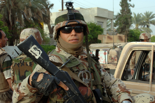 On April 3, 2006, Iraqi Soldiers from 1ST Battalion, 1ST Brigade, 6th DIV from Forward Operating Base Independence conducted Mulhallah 637 Clearance Operations to deny insurgents the opportunity to freely operate in the region. Homes were searched and the area was cordoned. A soldier provides outter security to fellow troops inside.(U.S. Army photo by STAFF SGT. Kevin L. Moses Sr.) (Released)
