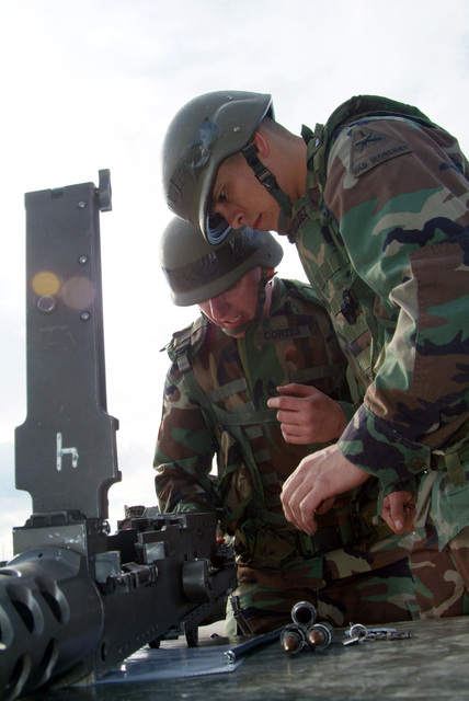 SGT. 1ST Class Cortes and another Spur candidate assemble a 50 Caliber machine gun. They are from 1ST Armored Division, 1ST U.S. Cavalry Regiment and are participating in a Spur Ride held April 3 and 4, 2006 in Buedingen Germany. (U.S. Army photo by Martin Greeson) (Released)